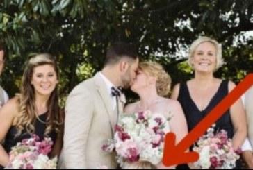 Булката и младоженеца се целуват на снимката! Но погледнете малката шаферка – тя събра погледите на всички!