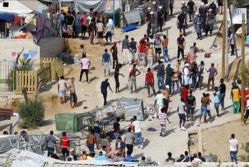 Мигранти в Германия скочиха на полицаи заради открито тяло в център за настаняване